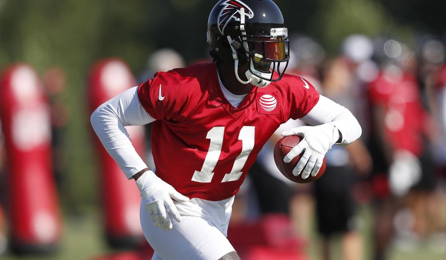 Atlanta Falcons wide receiver Julio Jones (11) runs after a catch during their NFL training camp football practice Thursday, July 25, 2019, in Flowery Branch, Ga. (AP Photo/John Bazemore)