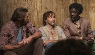 """This image released by Netflix shows Chris Evans, from left, Alessandro Nivola and Michael Kenneth Williams in a scene from """"The Red Sea Diving Resort."""" (Marcos Cruz/Netflix via AP)"""
