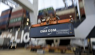 In this June, 19, 2018 photo, a ship to shore crane lifts a CMA CGM Group shipping container onto the Hapag-Lloyd Teno at the Port of Savannah in Savannah, Ga. The Georgia Ports Authority reported Tuesday, July 30, 2019, that its ports at Savannah and Brunswick handled a record 37.5 million tons (34 million metric tons) of cargo in the 2019 fiscal year that ended June 30. That's a 4.2% increase over the previous year. A whopping 4.5 million container units of imports and exports were shipped through Savannah. (AP Photo/Stephen B. Morton)