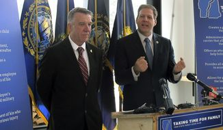 FILE - In this Jan. 16, 2019, file photo, Vermont Gov. Phil Scott, left, and his New Hampshire counterpart Gov. Chris Sununu, right, face reporters during a news conference in Littleton, N.H. In an opinion piece released Monday, July 29, 2019, Govs. Scott and Sununu urged Congress to approve the replacement to the North American Free Trade Agreement, or NAFTA, saying the U.S.-Mexico-Canada Agreement will benefit their two states and New England as a whole because of the close economic ties between the states and Canada. (AP Photo/Wilson Ring, File)