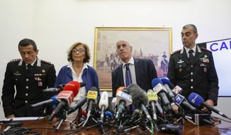 From left, Carabinieri Colonel Lorenzo D'Aloia, prosecutors Nunzia D'Elia, and Michele Prestipino, and Carabinieri General Francesco Gargano arrive to a press conference about the investigation on the murder of Carabinieri's officer Mario Cerciello Rega in Rome, Tuesday, July 30, 2019. Two American teenagers were jailed in Rome on Saturday as authorities investigate their alleged roles in the fatal stabbing of the Italian police officer on a street near their hotel. (AP Photo/Andrew Medichini)