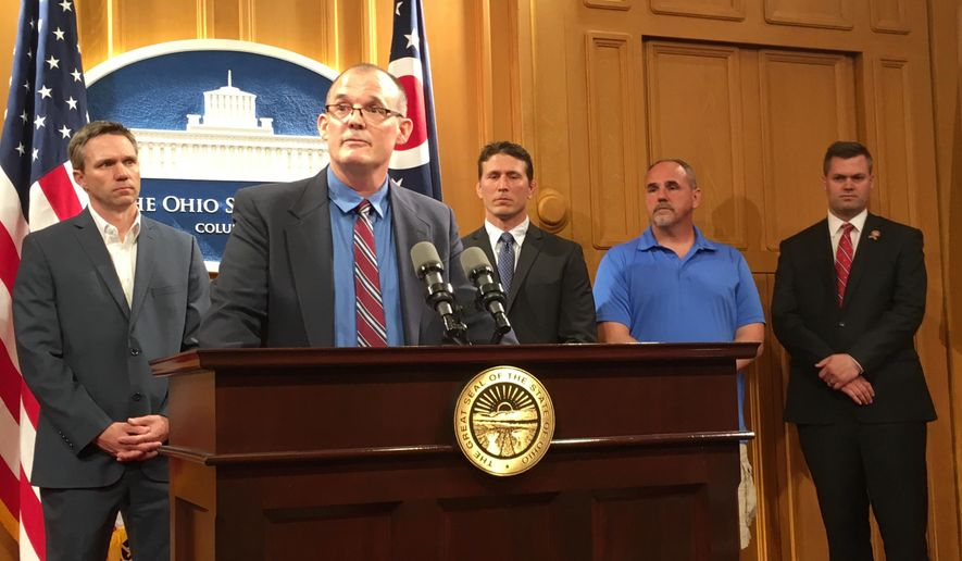 In a Tuesday, June 4, 2019, file photo, Roger Beedon discusses how sexual misconduct by now-deceased Ohio State team doctor Richard Strauss has affected his life, during a news conference with fellow Strauss accusers, from left, Brian Garrett, Dan Ritchie and Mike Flusche, and state Rep. Brett Hillyer, at the Statehouse in Columbus, Ohio. Men who say they were sexually abused by longtime Ohio State team doctor Richard Strauss are recounting how it changed their lives to make their case that the university owes them financial compensation. (AP Photo/Kantele Franko, File)