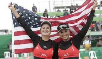 United States' Jace Pardon, right, and Karissa Cook celebrate after beating Argentina's Ana Gallay and Fernanda Pereyra to win the gold medal for the women's beach volleyball at the Pan American Games in Lima, Peru, Tuesday, July 30, 2019. (AP Photo/Silvia Izquierdo)