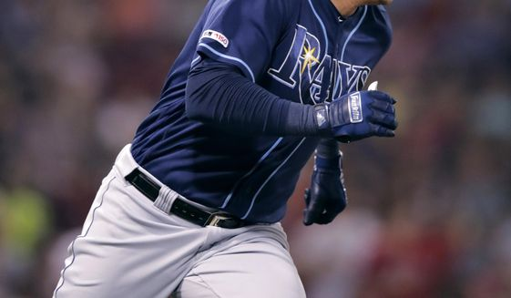 Tampa Bay Rays' Avisail Garcia dashes down the first base line on his two-run double during the sixth inning of the team's baseball game against the Boston Red Sox at Fenway Park in Boston, Tuesday, July 30, 2019. (AP Photo/Charles Krupa)