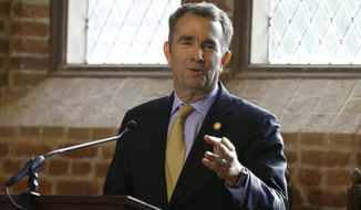 Virginia Gov. Ralph Northam addresses a commemorative meeting of the Virginia General Assembly on the 400th anniversary of the first House of Burgess meeting at a church in Historic Jamestown, Va., on the site where the meeting took place, Tuesday, July 30, 2019. (AP Photo/Steve Helber) ** FILE **