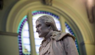 FILE - This Feb. 17, 2016 file photo shows statue of Thomas Jefferson greeting visitors in the main lobby of the Jefferson Hotel in Richmond, Va. Jefferson once wrote that African Americans smelled and were incapable for producing art and poetry. President Donald Trump may have raised eyebrows over a series of racist tweets in July 2019 but it's not the first time a U.S. president has sparked attention for racist gestures. (AP Photo/Steve Helber, File)