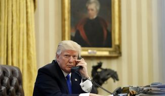 In this Saturday, Jan. 28, 2017, file photo, President Donald Trump speaks on the telephone with Australian Prime Minister Malcolm Turnbull in the Oval Office of the White House in Washington. (AP Photo/Alex Brandon, File)