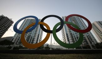 In this July 23, 2016, file photo, a representation of the Olympic rings are displayed in the Olympic Village in Rio de Janeiro, Brazil. A bill spurred by Larry Nassar's sex crimes and other mishandled abuse cases would allow Congress to fire the U.S. Olympic and Paralympic Committee's entire board and would quadruple the money the federation provides to the U.S. Center for SafeSport. (AP Photo/Leo Correa, File)