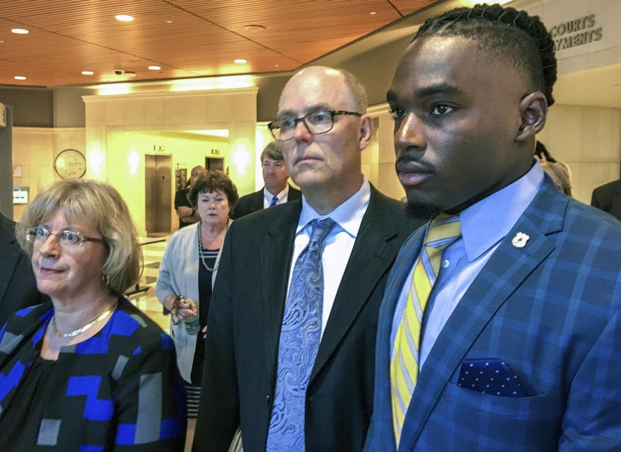 FILE - In this Aug. 23, 2018, file photo, University of Wisconsin wide receiver Quintez Cephus, right, walks with his attorneys Kathleen Stalling, left, and Stephen Meyer after appearing in court in Madison, Wis. The trial of Cephus has begun with a woman testifying that Cephus raped her in his apartment. The 21-year-old Cephus is charged with second- and third-degree sexual assault after two 18-year-old women reported to police that he had assaulted them on the same night in April 2018. Cephus argues the sex was consensual and arranged by one of the women. (Ed Treleven/Wisconsin State Journal via AP, File)