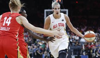 Washington Mystics' Elena Delle Donne, right, of Team Delle Donne, passes around Team Wilson during the first half of a WNBA All-Star basketball game Saturday, July 27, 2019, in Las Vegas. (AP Photo/John Locher) ** FILE **