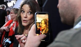 "Marianne Williamson, called a new leader for the ""religious left,"" pauses to talk to reporters following a debate in Detroit. (Associated Press)"