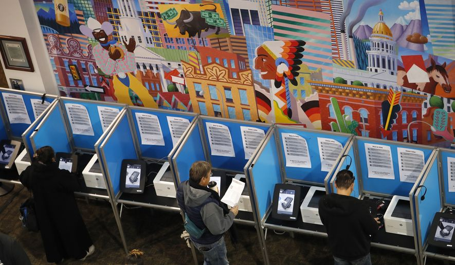 In this Nov. 6, 2018, file photo, voters cast their ballots at the Denver Elections Division in Denver. (AP Photo/David Zalubowski, File)