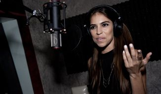 "Antonella Barba attends Reggie Benjamin's ""Mission Save Her"" recording session on Monday, Sept. 22, 2014, in Los Angeles. (Photo by Richard Shotwell/Invision/AP)"