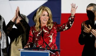 In this file photo, then-Texas Democratic gubernatorial candidate Wendy Davis waves to supporters after making her concession speech in Fort Worth, Texas. Ms. Davis is running for a U.S. House seat in 2020. (AP Photo/Tony Gutierrez, File)