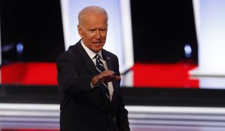 Former Vice President Joe Biden waves after the second of two Democratic presidential primary debates hosted by CNN Wednesday, July 31, 2019, in the Fox Theatre in Detroit. (AP Photo/Paul Sancya)