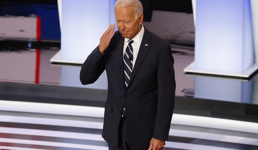 Former Vice President Joe Biden salutes as he is introduced at the second of two Democratic presidential primary debates hosted by CNN Wednesday, July 31, 2019, in the Fox Theatre in Detroit. (AP Photo/Paul Sancya)