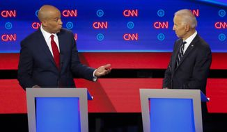 Sen. Cory Booker, D-N.J., speaks to former Vice President Joe Biden as they participate in the second of two Democratic presidential primary debates hosted by CNN Wednesday, July 31, 2019, in the Fox Theatre in Detroit. (AP Photo/Paul Sancya)
