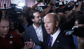Former Maryland Rep. John Delaney talks to reporters after the first of two Democratic presidential primary debates hosted by CNN Tuesday, July 30, 2019, in the Fox Theatre in Detroit. (AP Photo/Carlos Osorio)
