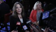 Marianne Williamson talks to reporters after the first of two Democratic presidential primary debates hosted by CNN Tuesday, July 30, 2019, in the Fox Theatre in Detroit. (AP Photo/Carlos Osorio)