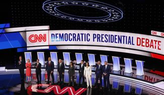 From left, Sen. Michael Bennet, D-Colo., Sen. Kirsten Gillibrand, D-N.Y., former Housing and Urban Development Secretary Julian Castro, Sen. Cory Booker, D-N.J., former Vice President Joe Biden, Sen. Kamala Harris, D-Calif., Andrew Yang, Rep. Tulsi Gabbard, D-Hawaii, Washington Gov. Jay Inslee and New York City Mayor Bill de Blasio are introduced before the second of two Democratic presidential primary debates hosted by CNN Wednesday, July 31, 2019, in the Fox Theatre in Detroit. (AP Photo/Paul Sancya)