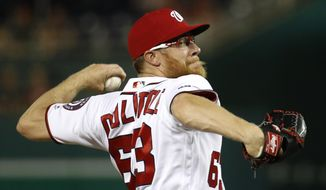 Washington Nationals relief pitcher Sean Doolittle throws to the Atlanta Braves in the ninth inning of a baseball game, Monday, July 29, 2019, in Washington. (AP Photo/Patrick Semansky)
