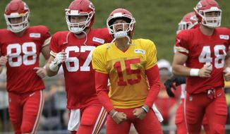 Kansas City Chiefs quarterback Patrick Mahomes (15) leads teammates onto the field for a drill during NFL football training camp Monday, July 29, 2019, in St. Joseph, Mo. (AP Photo/Charlie Riedel)
