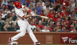 St. Louis Cardinals' Paul Goldschmidt hits a solo home run during the sixth inning of the team's baseball game against the Chicago Cubs on Tuesday, July 30, 2019, in St. Louis. (AP Photo/Jeff Roberson)
