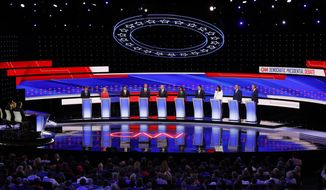 From left, Sen. Michael Bennet, D-Colo., Sen. Kirsten Gillibrand, D-N.Y., former Housing and Urban Development Secretary Julian Castro, Sen. Cory Booker, D-N.J., former Vice President Joe Biden, Sen. Kamala Harris, D-Calif., Andrew Yang, Rep. Tulsi Gabbard, D-Hawaii, Washington Gov. Jay Inslee and New York City Mayor Bill de Blasio participate in the second of two Democratic presidential primary debates hosted by CNN Wednesday, July 31, 2019, in the Fox Theatre in Detroit. (AP Photo/Paul Sancya)