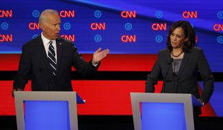 Former Vice President Joe Biden and Sen. Kamala Harris, D-Calif., participate in the second of two Democratic presidential primary debates hosted by CNN Wednesday, July 31, 2019, in the Fox Theatre in Detroit. (AP Photo/Paul Sancya)