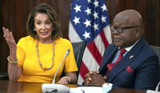 """US House Speaker Nancy Pelosi speaks with Speaker of the Parliament Aaron Mike Oquaye at Ghana's Parliament in Accra, Ghana, Wednesday, July 31, 2019.   Pelosi and other members of the U.S. Congress plan discussions on """"regional security, sustainable and inclusive development and the challenges of tomorrow including the climate crisis."""" (AP Photo/Christian Thompson)"""