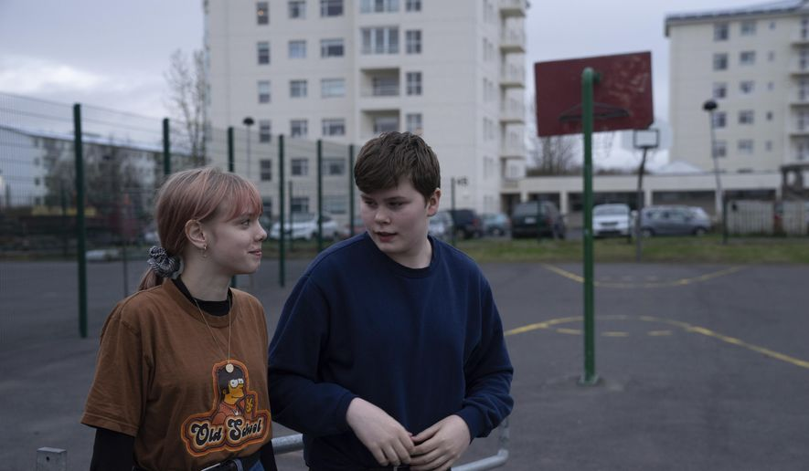 This photo taken Monday, May 13, 2019, shows Karen Guttensen and Ingvar Ingolfsson, right, both 14-years old, outside the Tjornin youth center in Reykjavik, Iceland, on a bright summer night.  The island nation in the North Atlantic has dried up a teenage culture of drinking and smoking by  focusing on local participation in music and sports options for students, with such success that Icelandic teens now have one of the lowest rates of substance abuse in Europe. (AP Photo/Egill Bjarnason)