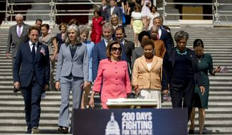 In this July 25, 2019, photo, House Speaker Nancy Pelosi of Calif., and House Democrats arrive for a news conference on the first 200 days of the 116th Congress at the House East Front steps of the Capitol in Washington. (AP Photo/Andrew Harnik) **FILE**
