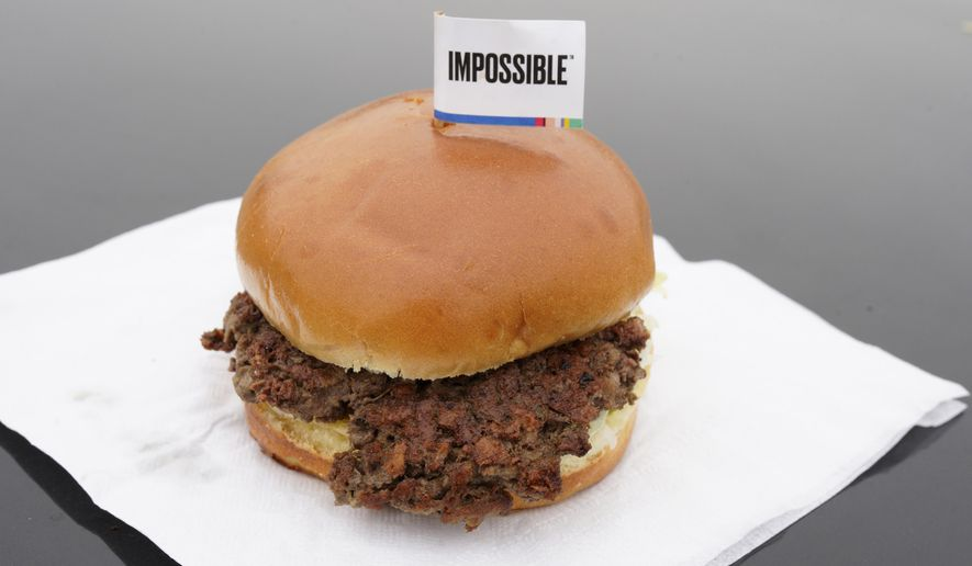 """Impossible Foods, based in Silicon Valley, announced this month that its """"meat made with plants"""" will be sold in 1,000 new supermarkets, such as Albertsons and Safeway, across Illinois, Indiana, Iowa and California. What's more, the global marketing research firm Nielsen Corp. reported last month that sales of meatless alternative protein products had increased by more than 200% during the coronavirus compared to the same period last year. (AP Photo/Nati Harnik, File)"""