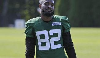 """FILE - In this July 25, 2019 file photo New York Jets Jamison Crowder participates during practice at the NFL football team's training camp in Florham Park, N.J. Crowder signed with the Jets as a free agent in the offseason because he envisioned plenty of action in Adam Gase's offense. Well, the wide receiver has caught on quickly in training camp, becoming a favorite target of Sam Darnold while showing how valuable he could be. """"I just want to be a weapon,"""" Crowder said Wednesday, July 31, 2019. """"Somebody that's reliable, somebody that's consistent. I just want to gain that trust with him that when he wants to go my way that he has that trust and that confidence that I'm going to make the play."""" (AP Photo/Seth Wenig, file)"""