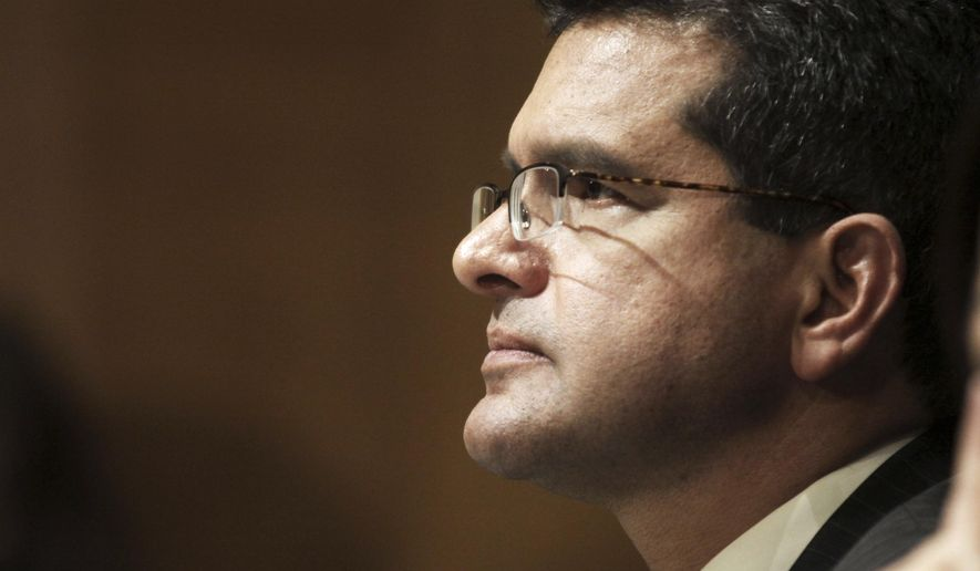 FILE - In this Sept. 29, 2015 file photo, Resident Commissioner Pedro Pierluisi, D-P.R., testifies before the Senate Finance Committee hearing on Puerto Rico's current economic conditions and long-term fiscal health, in Washington. A Puerto Rico legislator said Tuesday, July 30, 2019, that the U.S. territory's embattled governor plans to nominate  Pierluisi as secretary of state. (AP Photo/Lauren Victoria Burke, File)