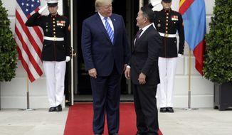 President Donald Trump greets Mongolian President Khaltmaa Battulga on the South Lawn of the White House, Wednesday, July 31, 2019, in Washington. (AP Photo/Evan Vucci)
