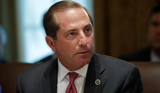 FILE - In this Tuesday, July 16, 2019, file photo, Health and Human Services Secretary Alex Azar pauses while speaking during a Cabinet meeting at the White House, in Washington. Azar says he and President Donald Trump are working on a plan to allow Americans to import lower-priced prescription drugs from Canada. (AP Photo/Alex Brandon, File)