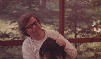 A young, smiling, shaggy-haired Bill Schulz sitting on my family's back porch in Carmel, New York. In his lap is the scruffy family dog named Lady Muttley.