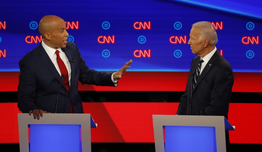 Sen. Cory Booker, D-N.J., gestures to former Vice President Joe Biden during the second of two Democratic presidential primary debates hosted by CNN Wednesday, July 31, 2019, in the Fox Theatre in Detroit. (AP Photo/Paul Sancya)