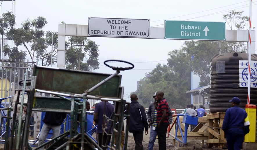 A view of the Poids Lourd checkpoint on the border between Congo and Rwanda, Thursday, Aug. 1, 2019. Congo's presidency says the border is open again with Rwanda hours after its eastern neighbor closed it over the deadly Ebola outbreak. Congo had protested the closure, which went against international health recommendations. The closure occurred Thursday morning as the first case of direct transmission of the Ebola virus was confirmed in Goma, the Congo city of more than 2 million people on the Rwandan border. (AP Photo)