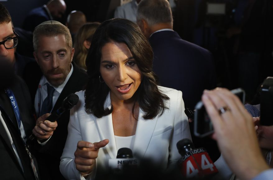 Rep. Tulsi Gabbard, Hawaii Democrat, answers questions after the second of two Democratic presidential primary debates hosted by CNN Thursday, Aug. 1, 2019, in the Fox Theatre in Detroit. (AP Photo/Paul Sancya)