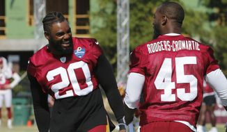 Washington Redskins strong safety Landon Collins (20) and cornerback Dominique Rodgers-Cromartie (45) talk during the Redskins NFL football training camp in Richmond, Va., Thursday, Aug. 1, 2019. (AP Photo/Steve Helber) **FILE**