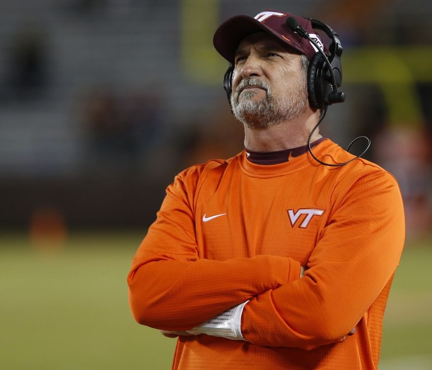 In this Oct. 25, 2018, file photo, Virginia Tech defensive coordinator Bud Foster looks at the scoreboard during the second half of an NCAA college football game against Georgia Tech, in Blacksburg, Va. Foster says the upcoming football season will be his final as an assistant coach. Foster has been the Hokies defensive coordinator since 1995. His 33 years on staff makes him the longest tenured assistant coach in the country at the same school. (AP Photo/Steve Helber, File) **FILE**