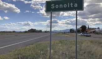 FILE - In this May 13, 2019, file photo, a sign for Sonoita stands in the heart of southeastern Arizona where owners of wineries and other small tourism operations worry that the Rosemont Copper Mine proposed to be built in the nearby Santa Rita Mountains could harm their businesses with mining trucks rumbling down scenic state highway 83 that runs past the range. A federal judge on Wednesday, July 31, 2019, has overturned the U.S. Forest Service's approval of a Canadian company's planned new copper mine in southeastern Arizona. The judge ruled the agency improperly evaluated and considered water use issues associated with the Rosemont Mine planned in the Santa Rita Mountains on part of the Coronado National Forest. (AP Photo/Anita Snow, File)