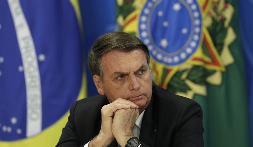 Brazil's President Jair Bolsonaro holds a press conference on deforestation in the Amazon at the Planalto presidential palace in Brasilia, Brazil, Thursday, Aug. 1, 2019. Bolsonaro is threatening to dismiss officers at the agency that monitors deforestation in the Amazon over its publication of data he disagrees with. (AP Photo/Eraldo Peres) ** FILE **