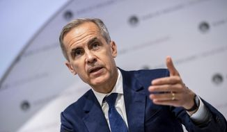 "Governor of the Bank of England, Mark Carney speaks during the Bank of England interest rate decision and inflation report press conference at the Bank of England in London,  Thursday, Aug. 1, 2019. Brexit uncertainties are becoming ""more entrenched"" and increasingly weighing on the British economy less than three months before the country is scheduled to leave the European Union, the Bank of England said Thursday.(Chris J Ratcliffe/Pool Photo via AP)"