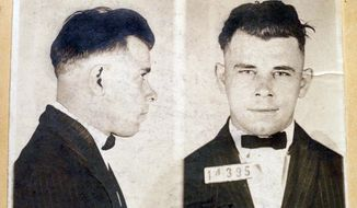FILE - This file photo shows Indiana Reformatory booking shots of John Dillinger, stored in the state archives, and shows the notorious gangster as a 21-year-old. Records show that Dillinger was admitted into the reformatory on Sept. 16, 1924. The body of the 1930s gangster is set to be exhumed from an Indianapolis cemetery more than 85 years after he was killed by FBI agents. The Indiana State Department of Health approved a permit July 3, 2019, that Dillinger's nephew, Michael C. Thompson, sought to have the body exhumed from Crown Hill Cemetery and reinterred there.(AP Photo/The Indianapolis Star, Charlie Nye, File)
