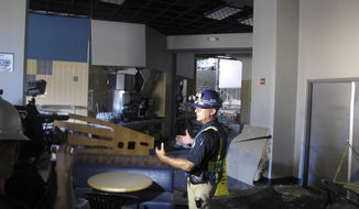 FILE - In this Thursday, July 11, 2019, file photo, University of Nevada, Reno Police Chief Todd Renwick describes the damage inside a school dormitory from a July 5 natural gas explosion, in Reno, Nev., during a tour. The University of Nevada, Reno signed a $21.7 million lease agreement Thursday, Aug. 1 to house 1,300 students at a downtown hotel-casino during the coming school year after the natural gas explosion forced the closure of two main residence halls. (AP Photo/Scott Sonner, File)
