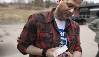 Travis Paulson of Eveleth, Minn., points out the insulin that he purchased on a recent to trip, Saturday May 4, 2019 in Eveleth, Minn. Travis lead a caravan for six Minnesotans who traveled to Ontario Canada to purchase insulin. (Jerry Holt/Star Tribune via AP)