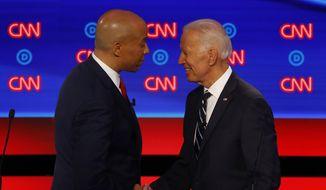Sen. Cory Booker, D-N.J., shakes hands with former Vice President Joe Biden after the second of two Democratic presidential primary debates hosted by CNN Wednesday, July 31, 2019, in the Fox Theatre in Detroit. (AP Photo/Paul Sancya)